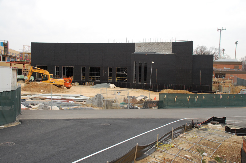 The exterior is going up on the new gyms, as seen from the road to the swimming pool